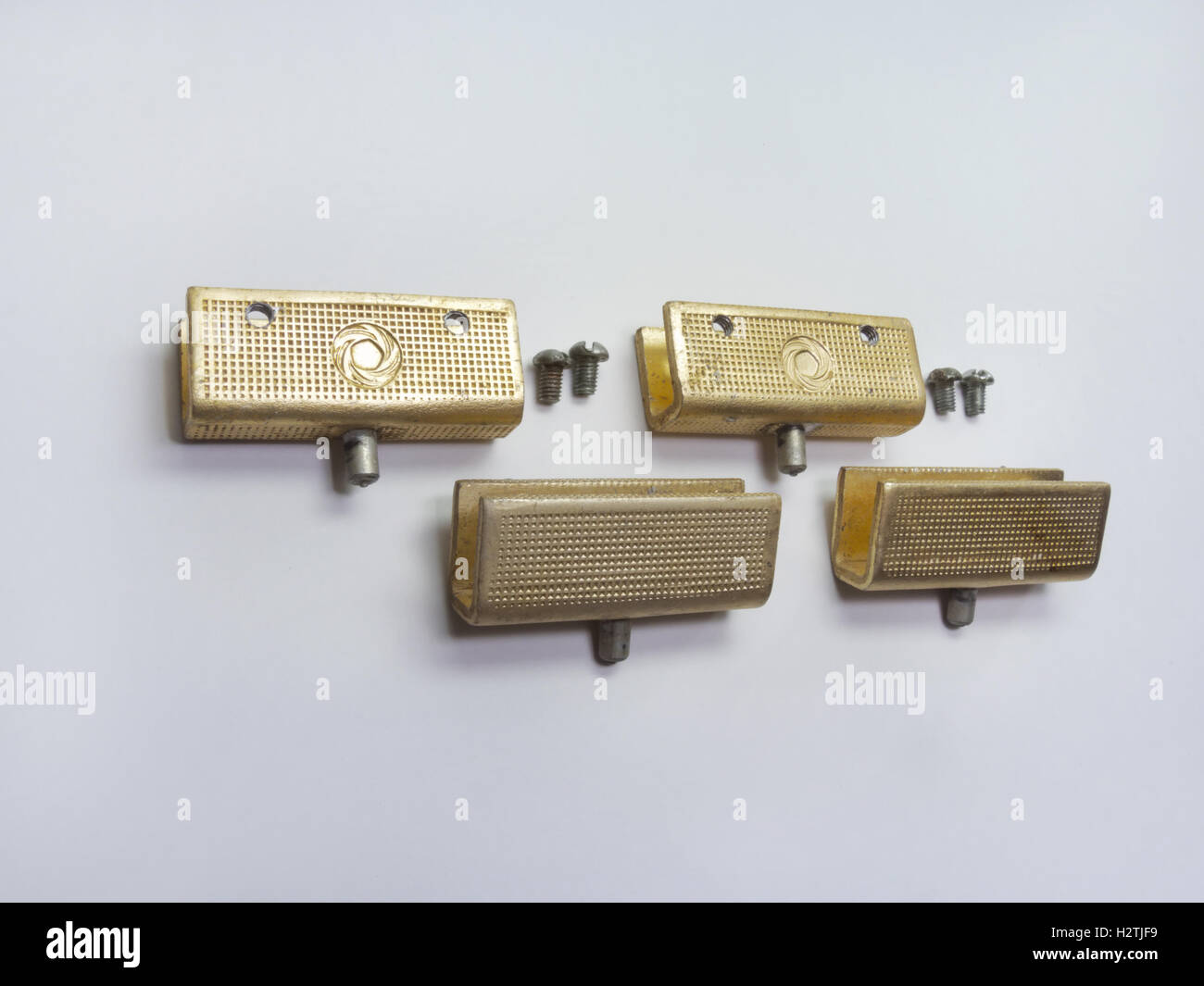 The glass door pivot hinge from sideboard. Elegant vintage, textured and with gilded - Stock Image