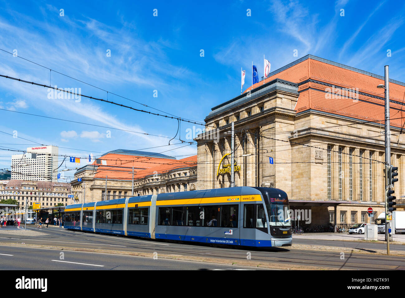 Tram in front of the Hauptbahnhof, one of the largest railway stations in Europe, Leipzig, Saxony, Germany - Stock Image