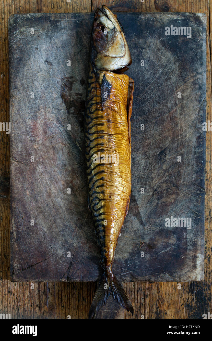 Smoked mackerel on the wooden board - Stock Image
