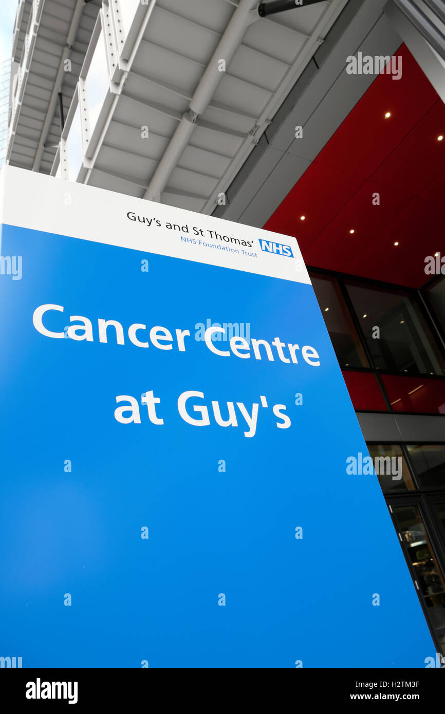 Cancer Centre at Guys Hospital sign at the entrance of the new hospital in Southwark, South London, England, UK - Stock Image