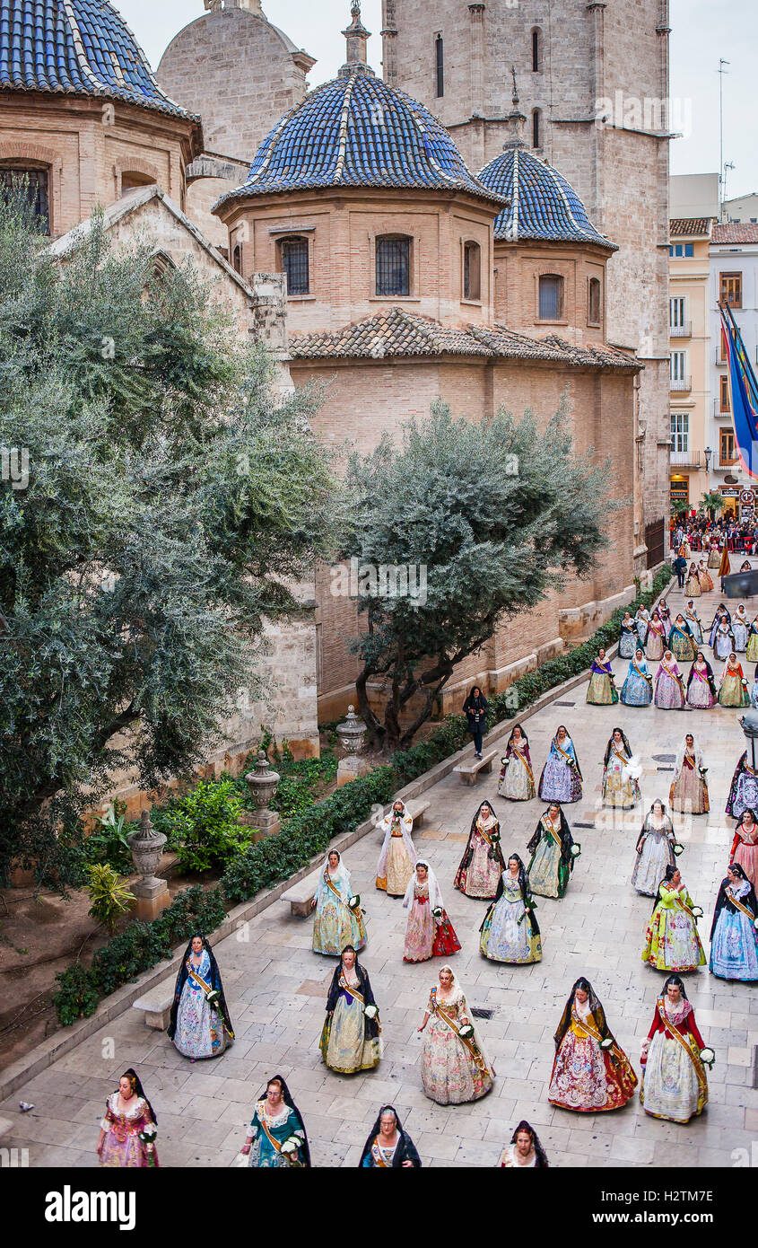 Flower offering parade,People with Floral tributes to `Virgen de los desamparados´, Fallas festival,carrer del Micalet Stock Photo