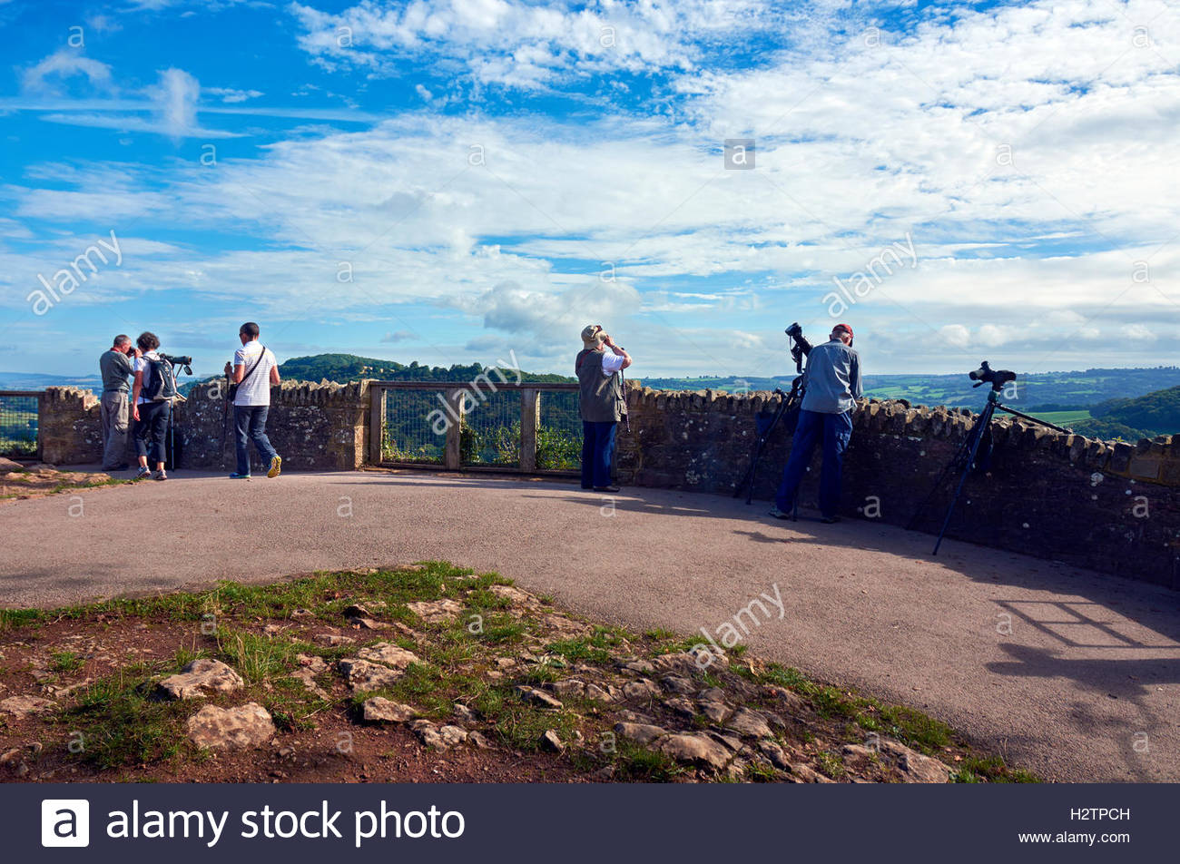 People with cameras and scope on the Symonds Yat rock viewpoint in the Wye Valley - Stock Image