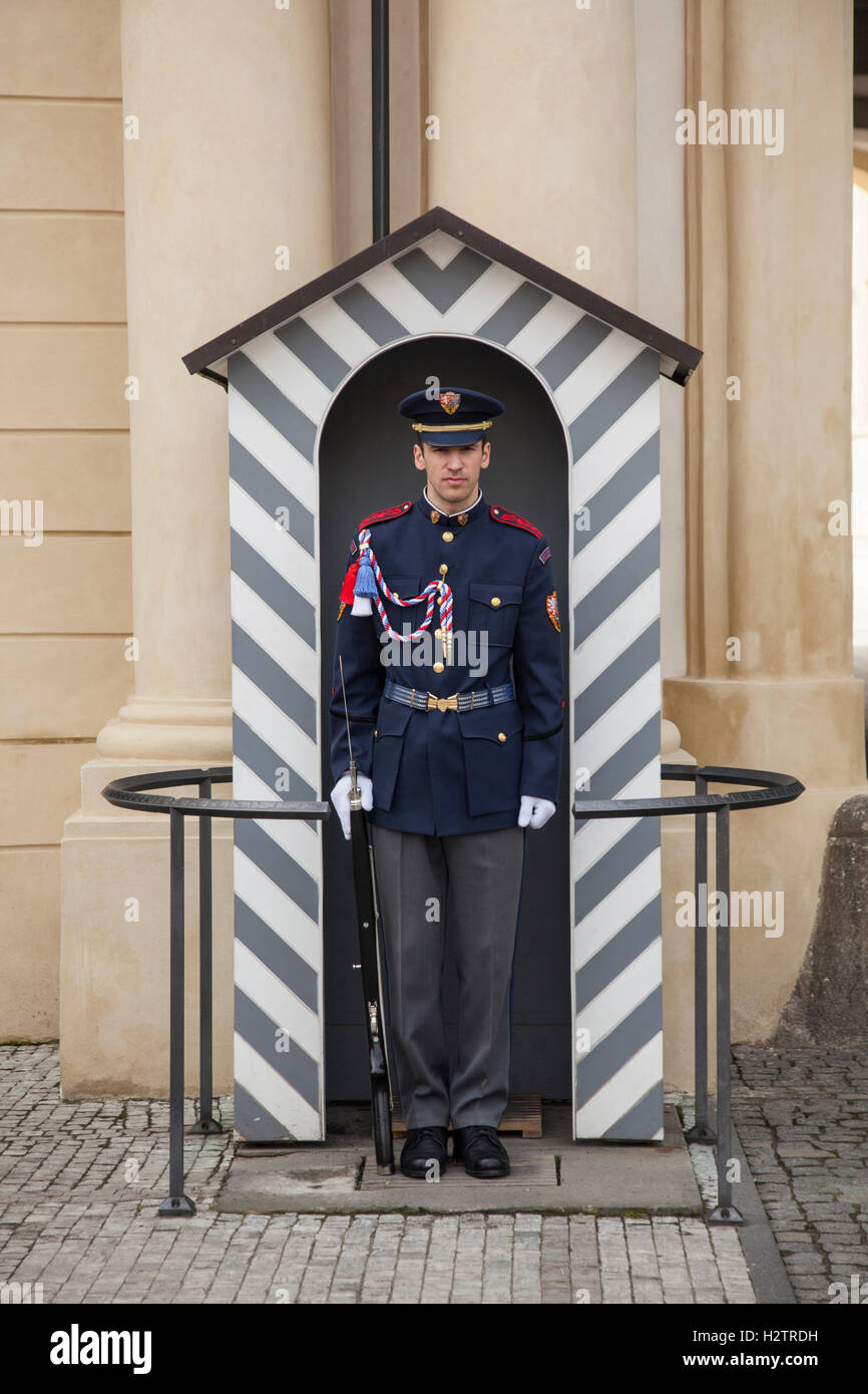 Czech soldier standing to attention in a sentry box at Prague Castle. - Stock Image