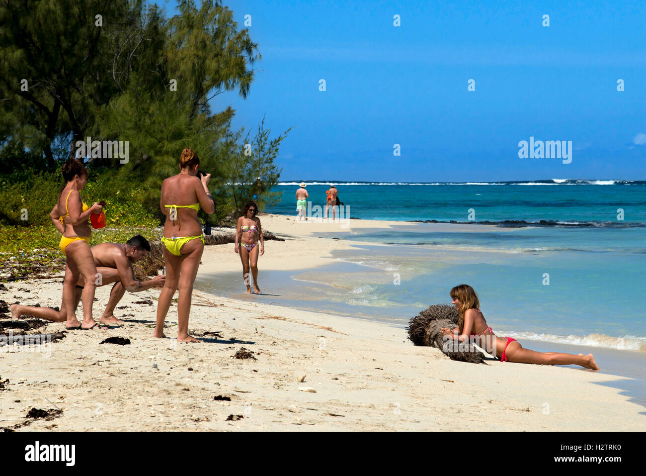 Tourists at the beach in Ile aux Cerfs, Flacq District, Republic of Mauritius. - Stock Image