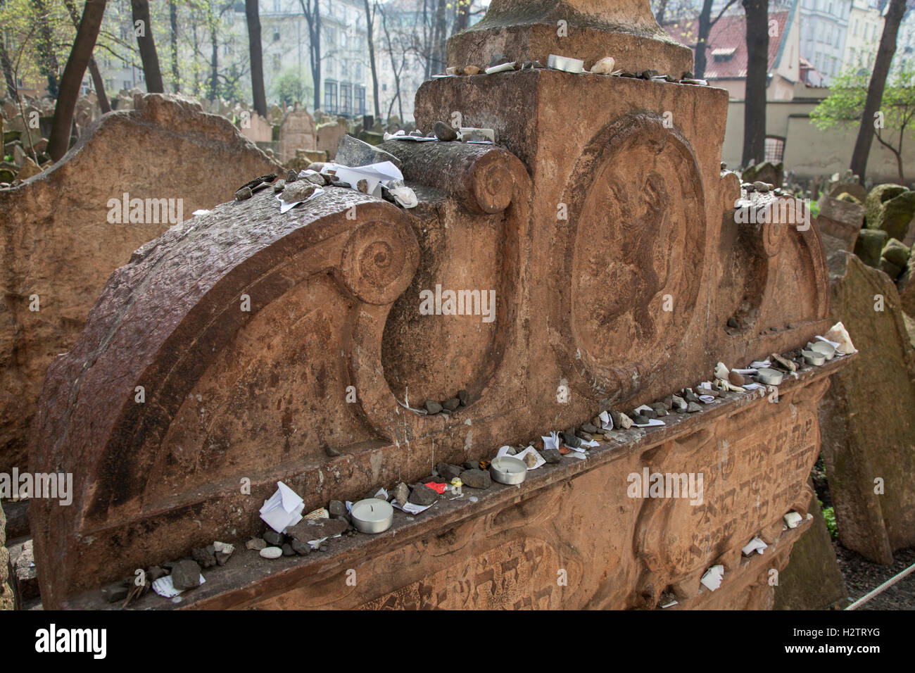 gravesOld Jewish Cemetery Prague. Sometimes visitors leave pebbles or prayers written on small pieces of paper on - Stock Image