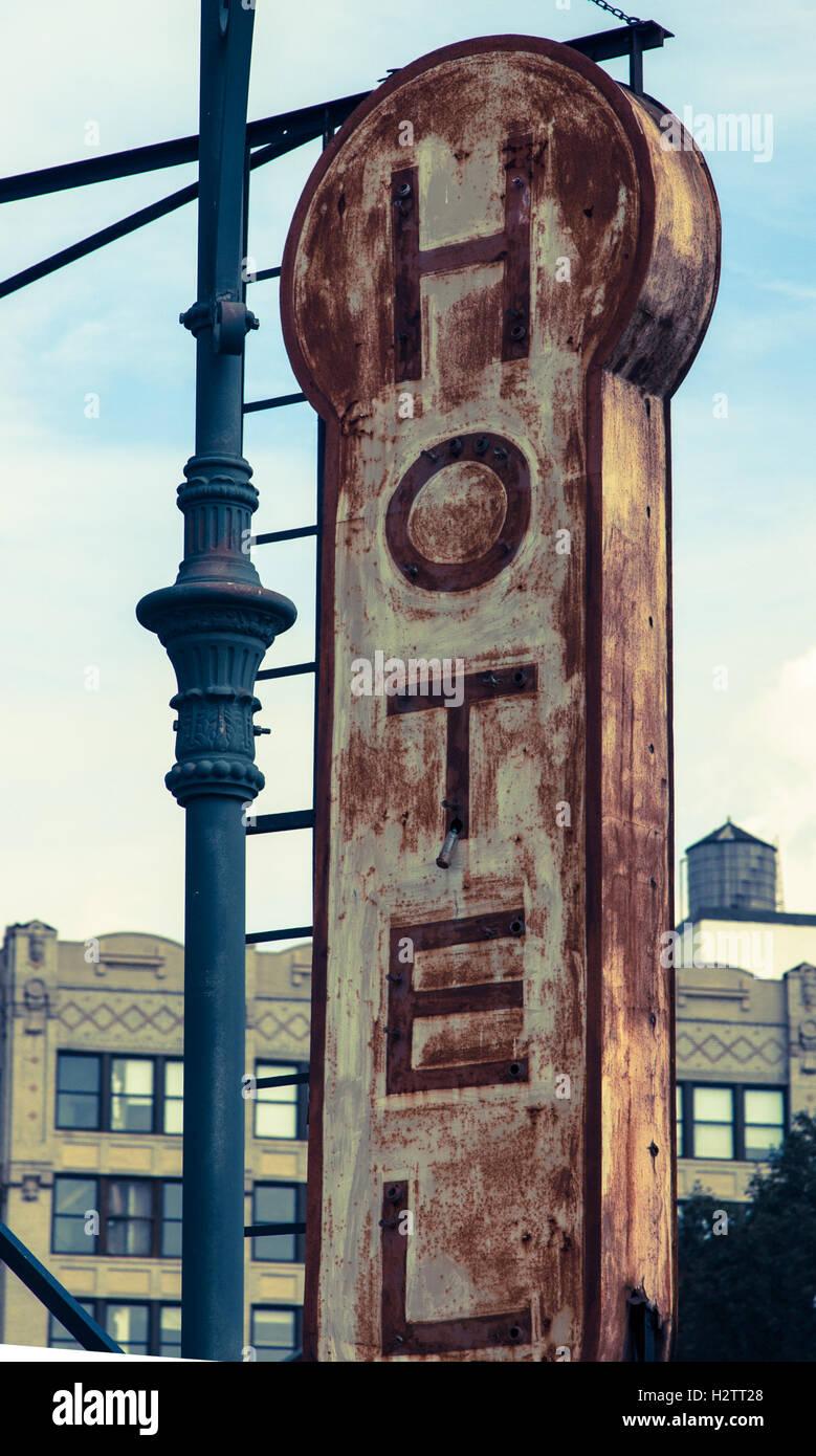 Old decrepit Hotel sign - Stock Image