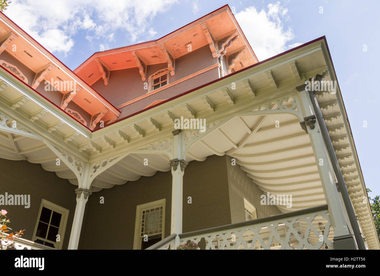 Veranda of the Asa Packer Mansion. The detailed woodwork of the eves and veranda roof of this venerable house in - Stock Image