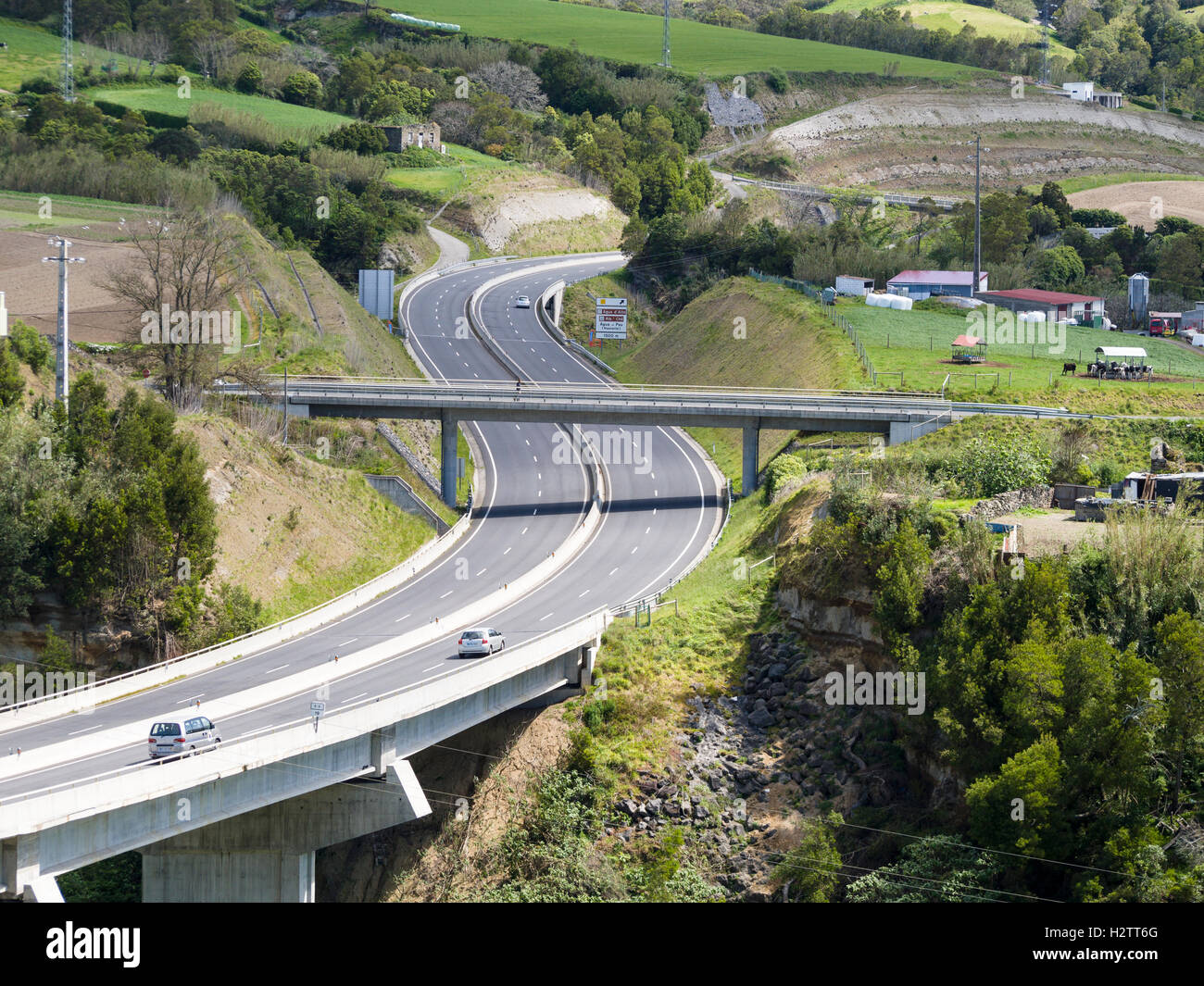 Sao Miguel's EN1 Highway busy. A superhighway for a small island, the new dual carriageway whisks visitors down - Stock Image
