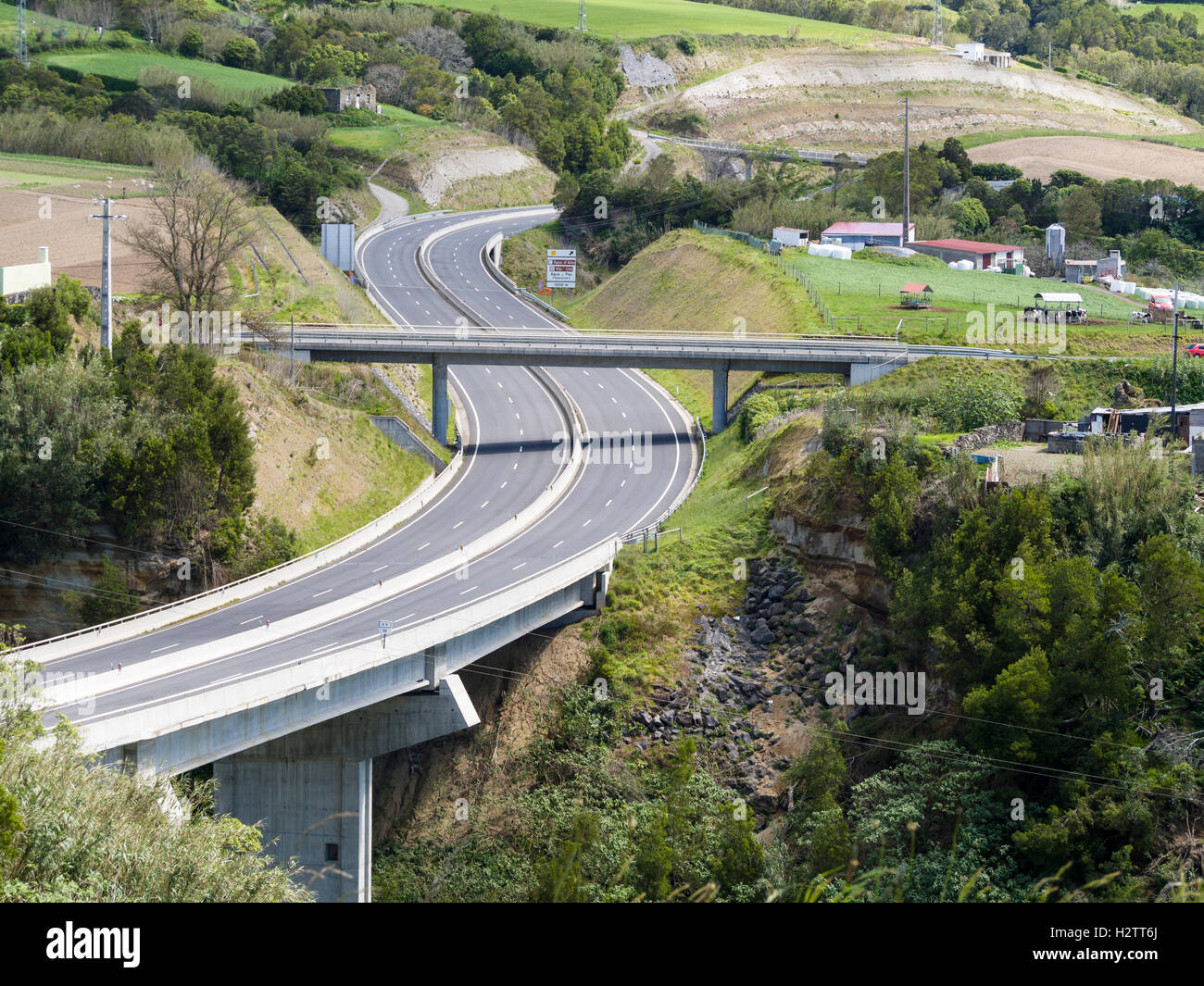 Sao Miguel's EN1 Highway empty. A superhighway for a small island, the new dual carriageway whisks visitors - Stock Image
