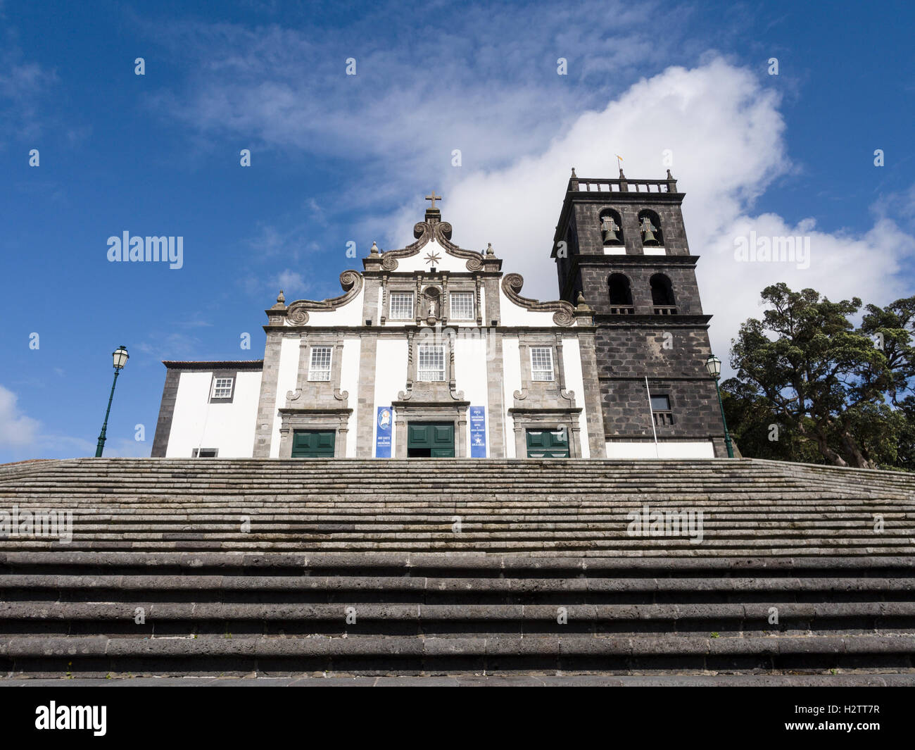 Church of Nossa Senhora da Estrela. The wide stair from from the town square to the solidly built stone church - Stock Image