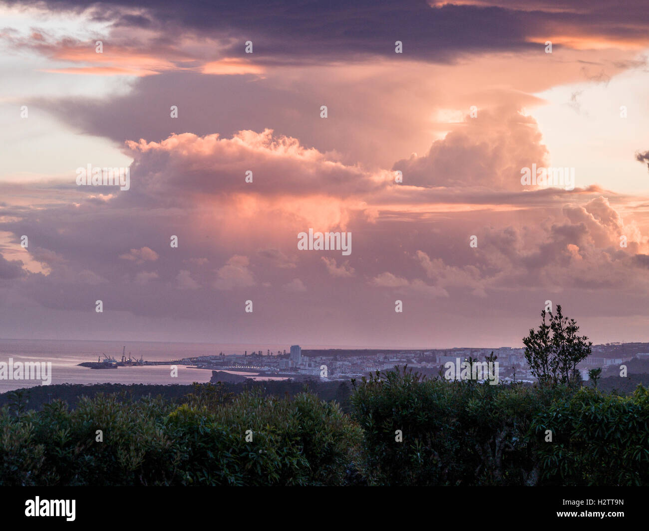 Storm Clouds above Ponta Delgada. High clouds move over the Azorian capital city and its harbour as the setting - Stock Image