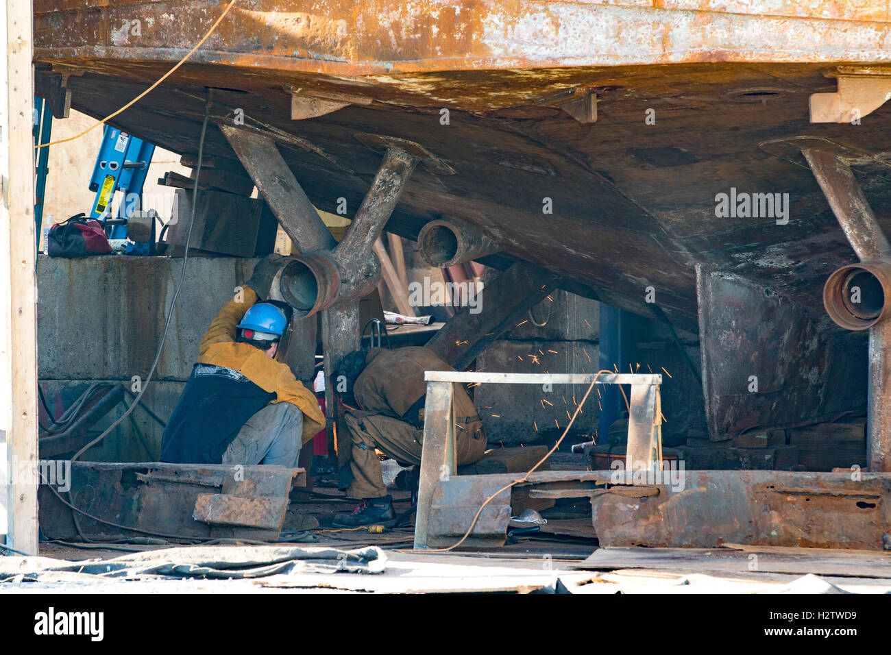 Steel boat, ship repair at dry dock by shipwright in Port Townsend boat yard. - Stock Image