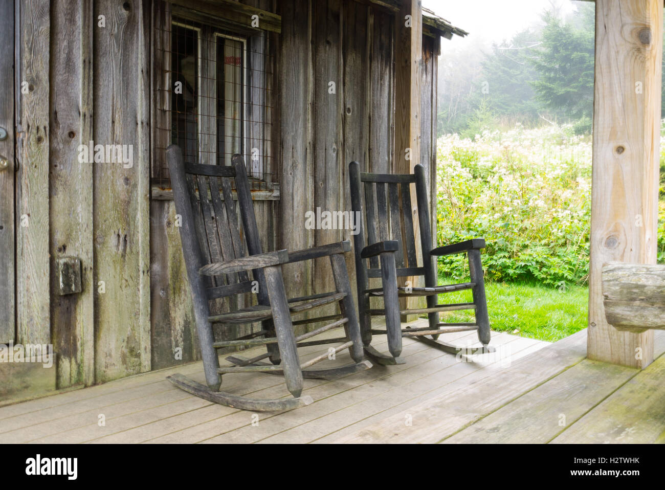 Rocking chairs on the porch of a cabin on Mt. LeConte in the Great Smoky Mountains National Park - Stock Image