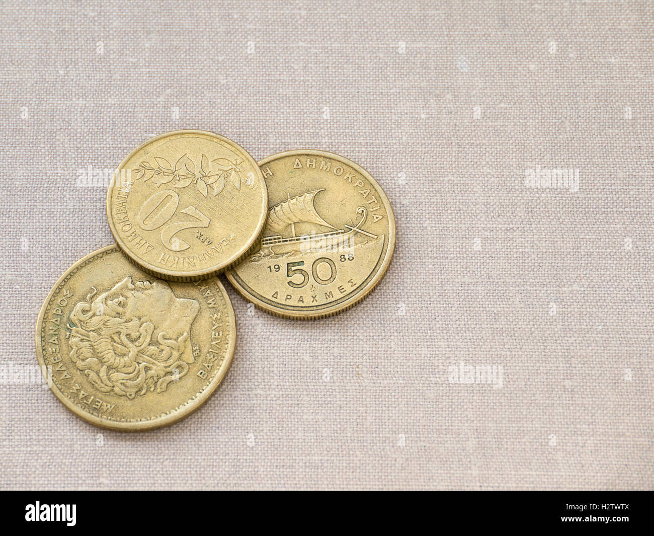 Greek drachma coins on the canvas background - Stock Image