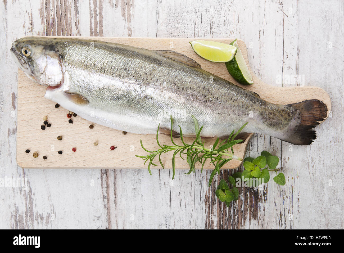 Trout on wooden kitchen board. - Stock Image