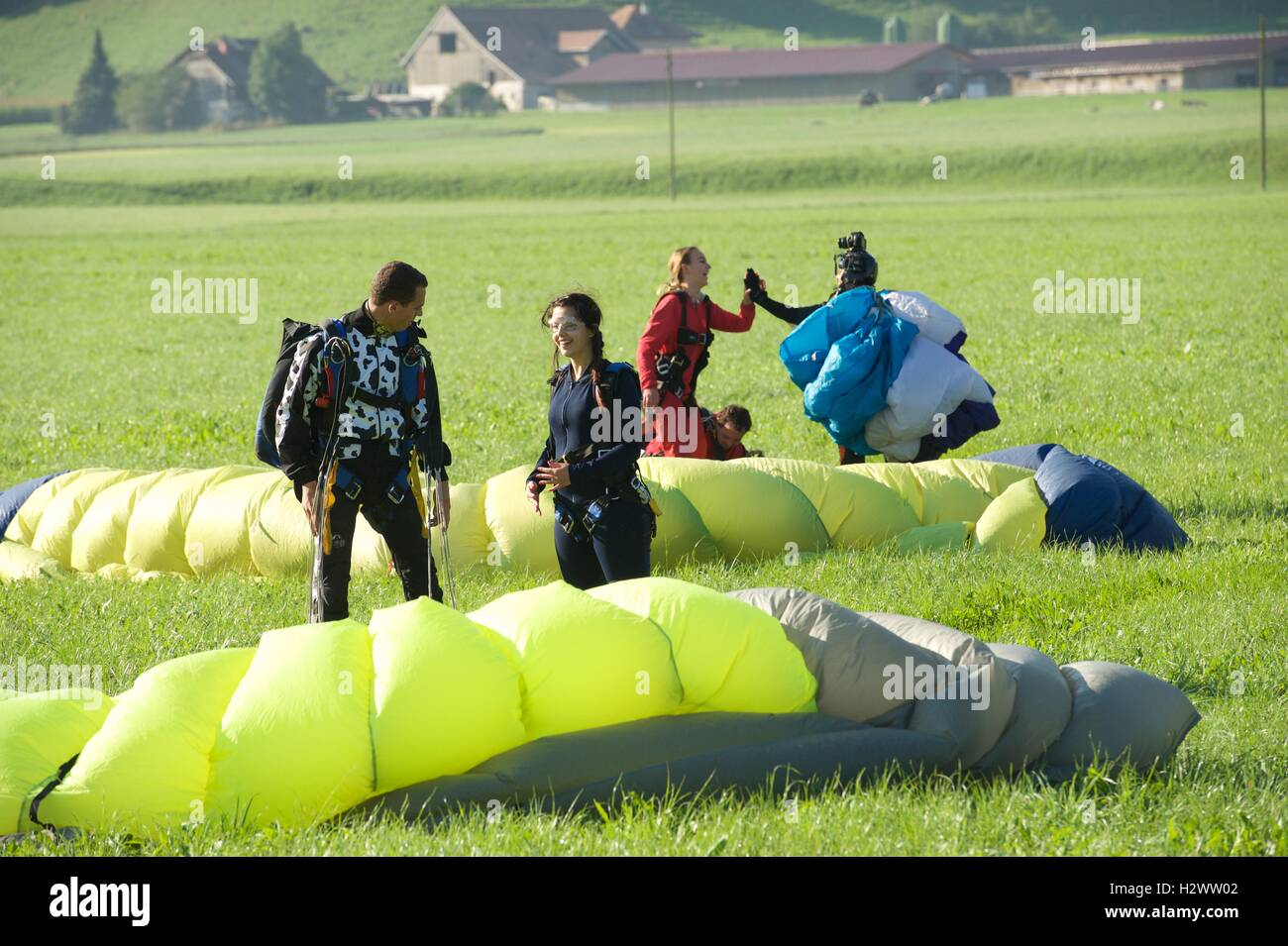 Happy poeple after happy landings - Stock Image