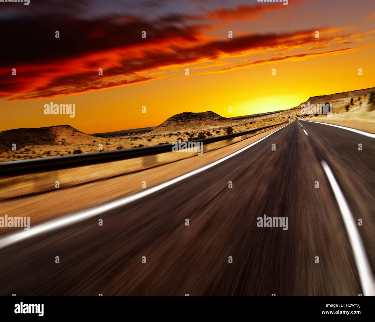 Road in desert with motion blur Stock Photo