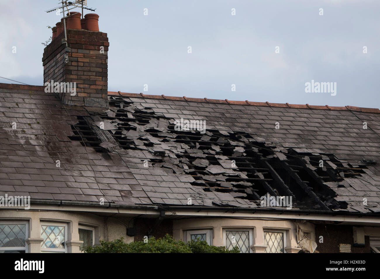 Fire damage to a residential home property house in Cardiff, Wales. - Stock Image