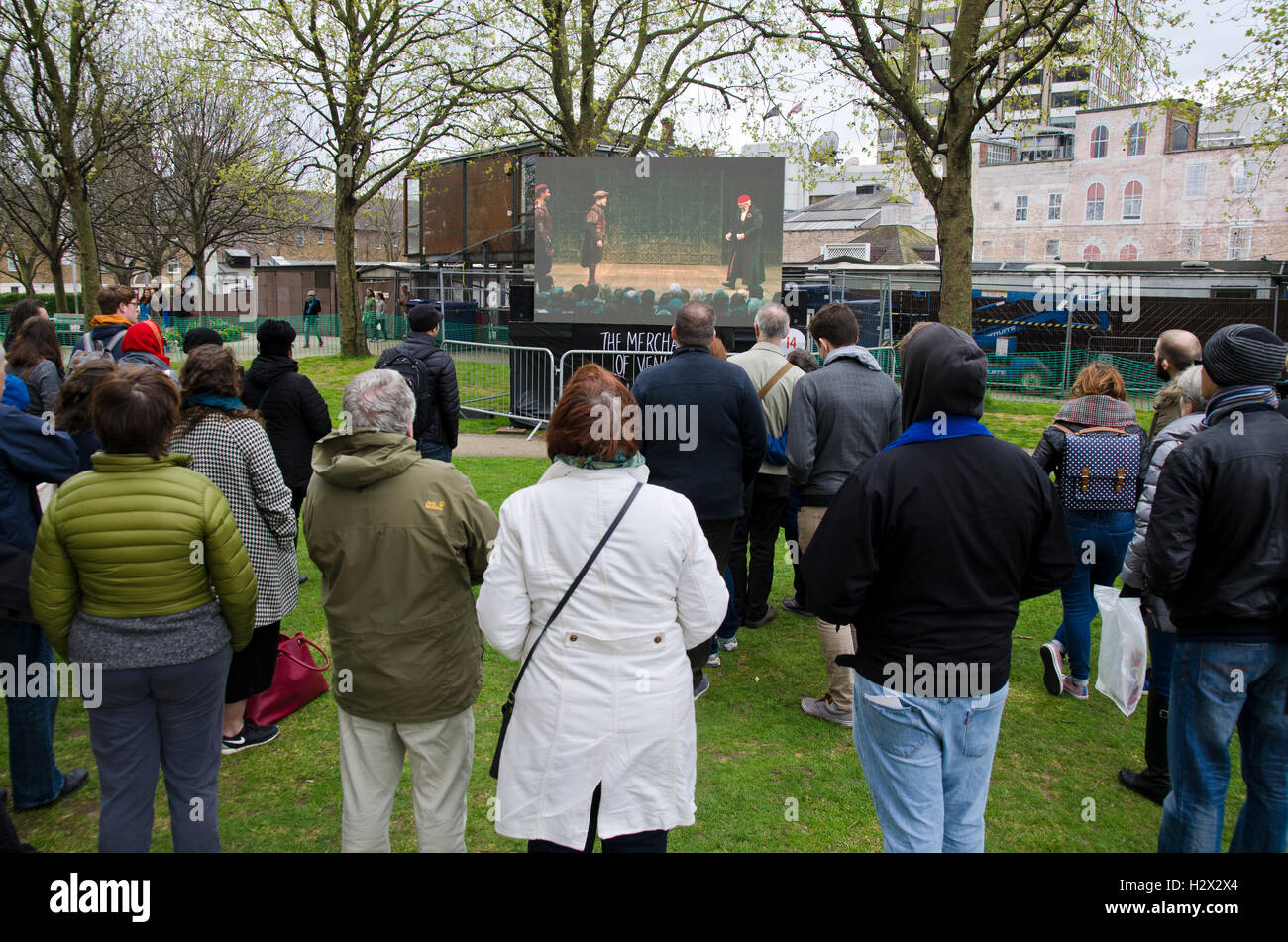 The Merchant of Venice is a play by William Shakespeare/ plays in open air, crowd watching in the park - Stock Image