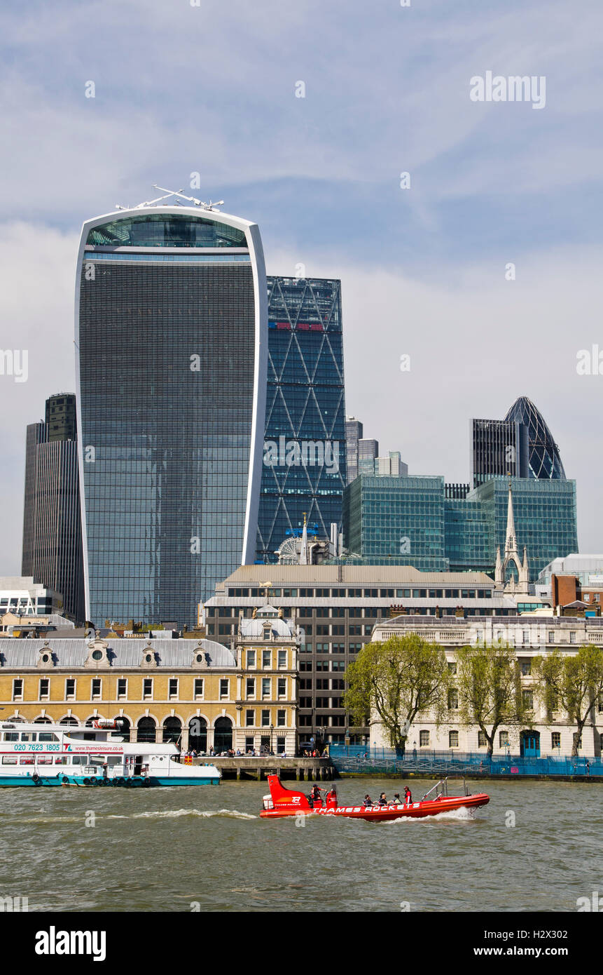 London skyscraper Walkie Talkie / Red speed boat - Stock Image