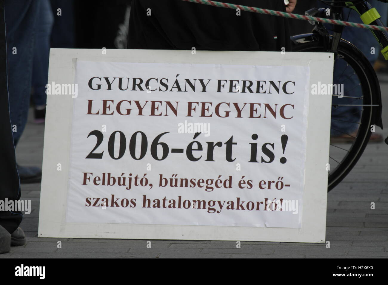 A sign stands on the ground, calling for a conviction of the Democratic Coalition party leader Ferenc Gyurcsany. Stock Photo
