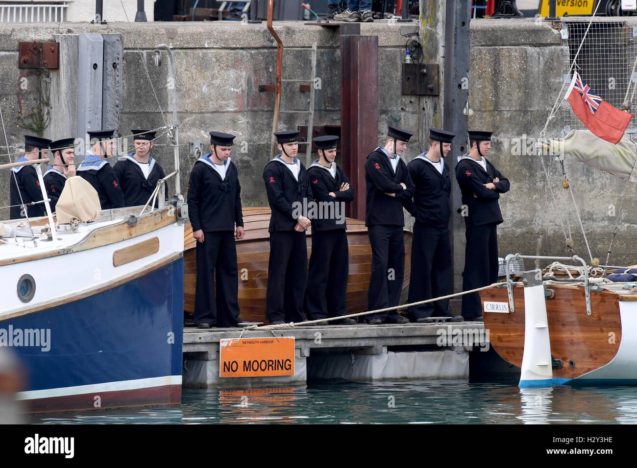 Harry Styles and Tom Hardy fans wait in Weymouth, Dorset as they are due to be filming the war movie Dunkirk. WeymouthStock Photo