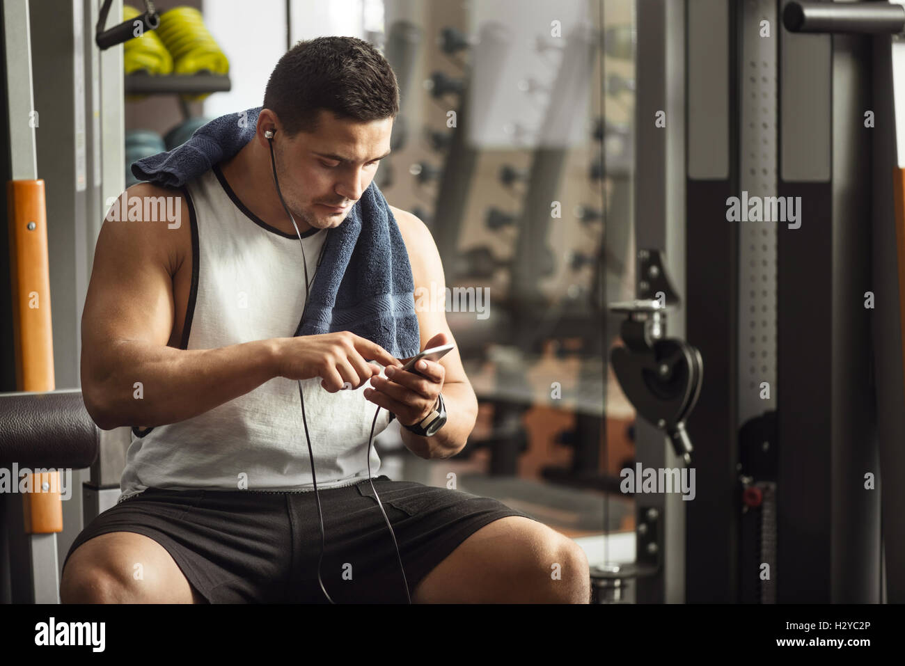 Pleasant nice man looking through his playlist - Stock Image