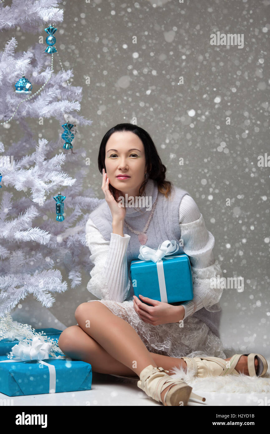 Beautiful Japanese girl with gifts in decorated Christmas tree Stock ...