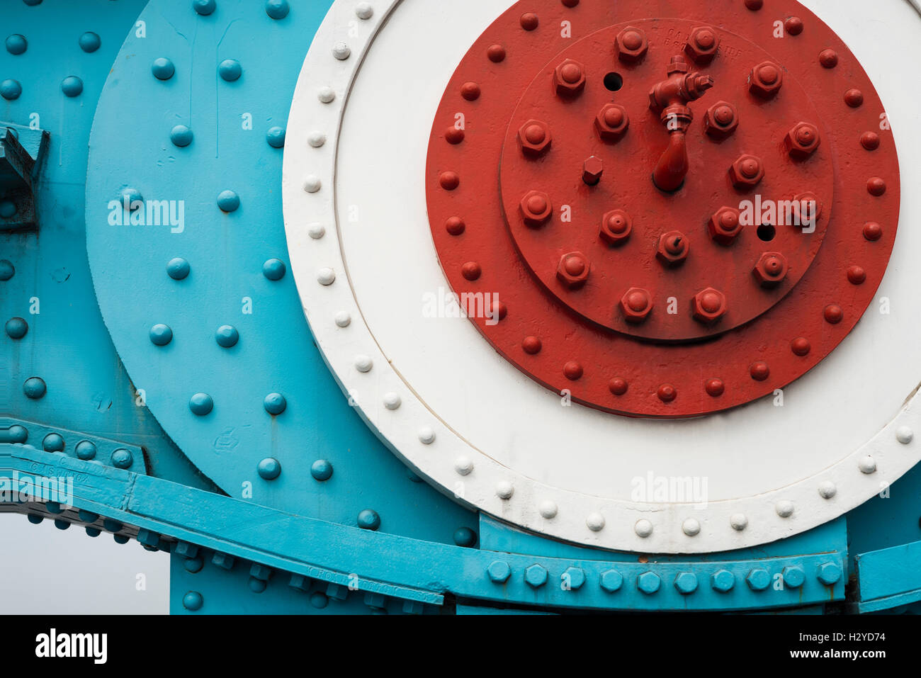 Colorfully painted steel parts with nuts, bolts and rivets of two chain link elements of the Tower Bridge suspension bridge in London, UK Stock Photo