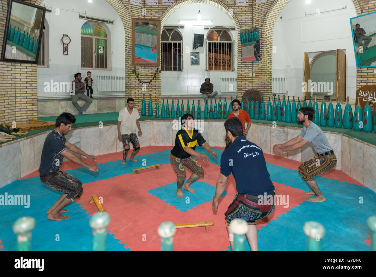 Meybod, The Local Zurkhaneh (Zoorkhaneh), Pahlevans Practising After The Evening Prayer - Stock Image
