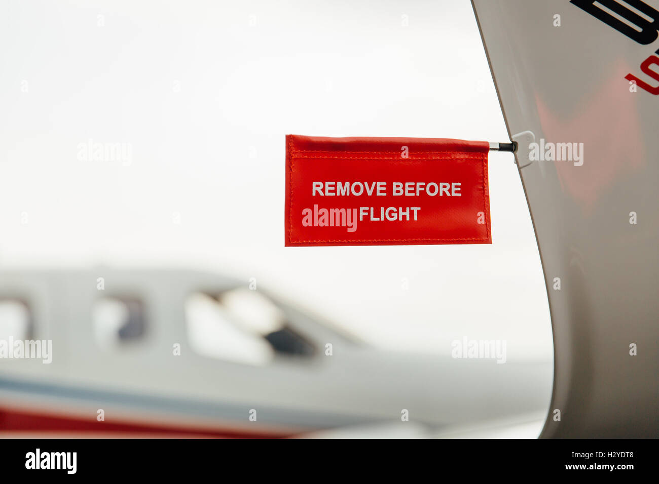 Remove before flight tag on an airplane wing - Stock Image