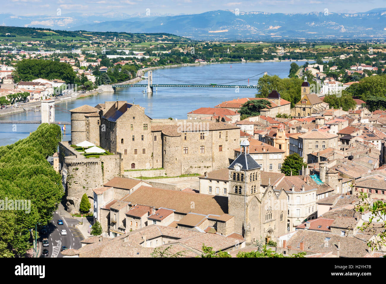 Views over the town of Tournon-sur-Rhône, its Château and the Rhône River separating the Drôme - Stock Image