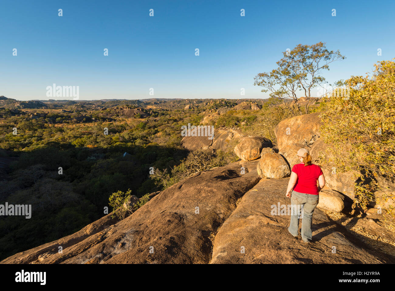 Matobo National Park walking exploring tourist red - Stock Image