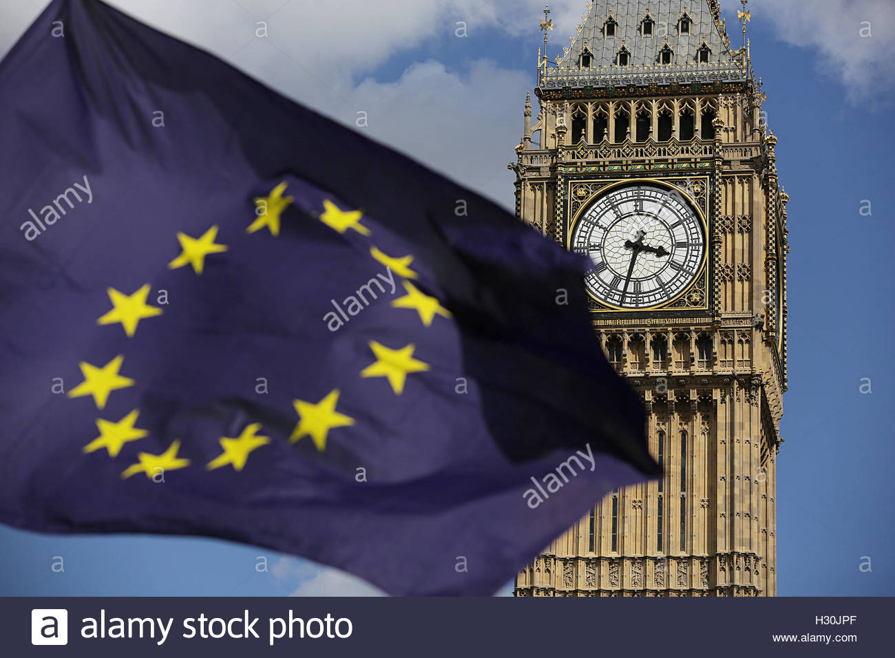 File photo dated 02/07/16 of a European Union flag in front of Elizabeth Tower in Westminster. Theresa May will - Stock Image
