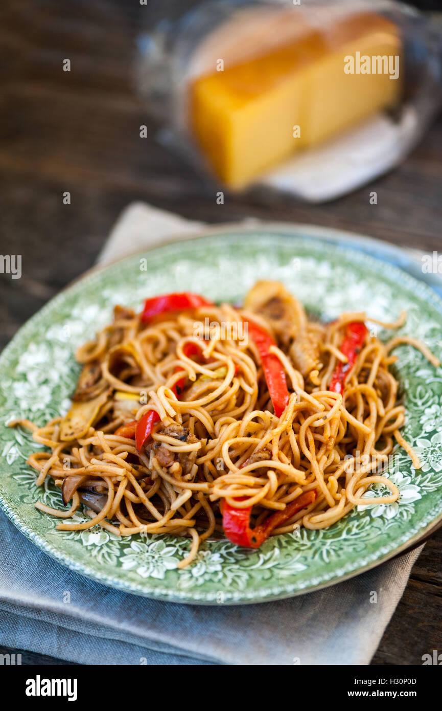 Noodles with eggplant, zucchini and red pepper - Stock Image