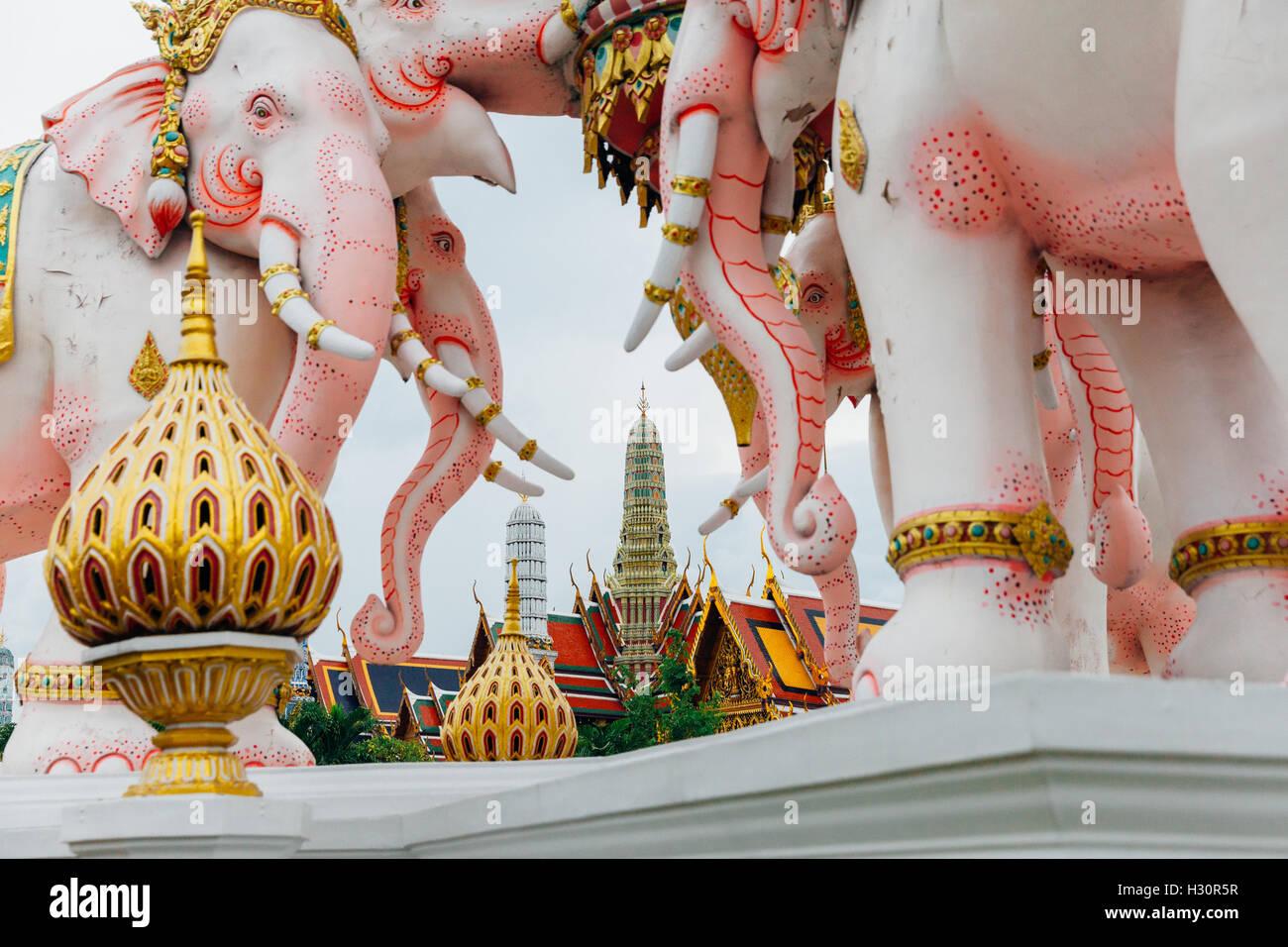 Grand Palace seen through the Pink Elephant Statue, Bangkok, Thailand - Stock Image