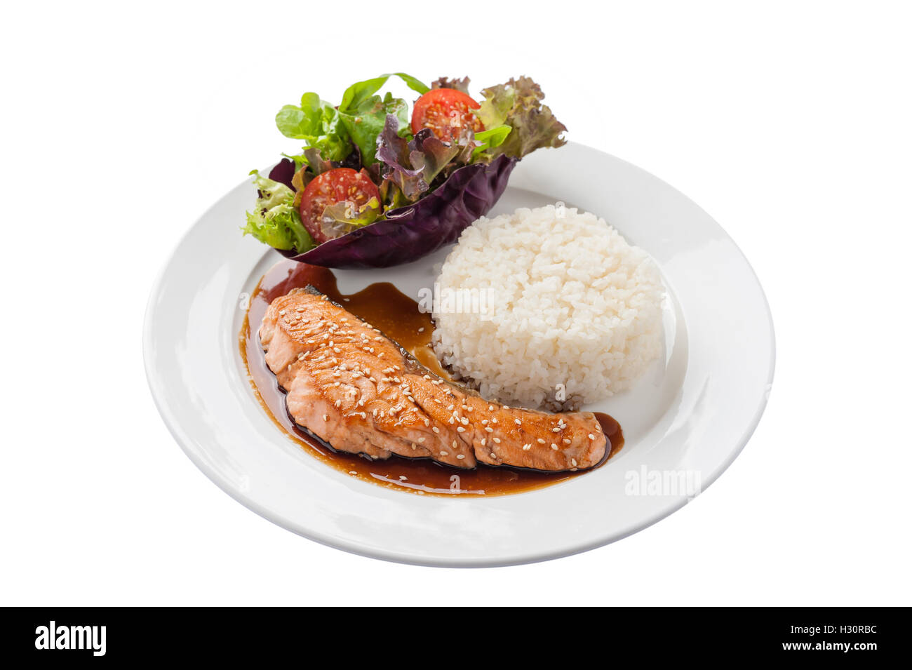 Front view of Fusion food style grilled salmon dressed with Japanese sweet sauce (Teriyaki) including Thai rice Stock Photo
