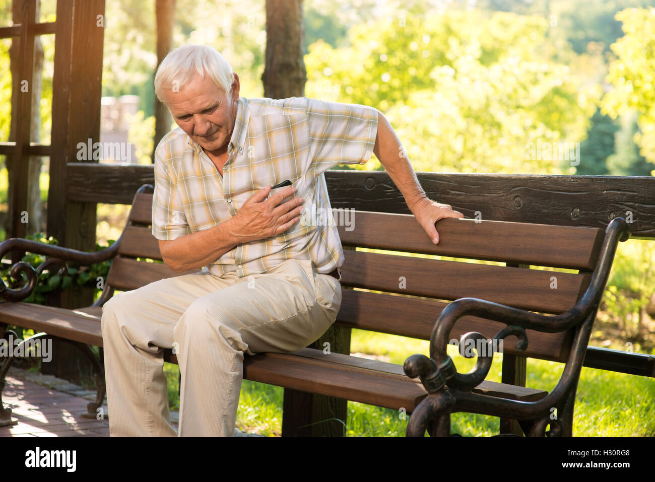 Senior guy has heartache. - Stock Image