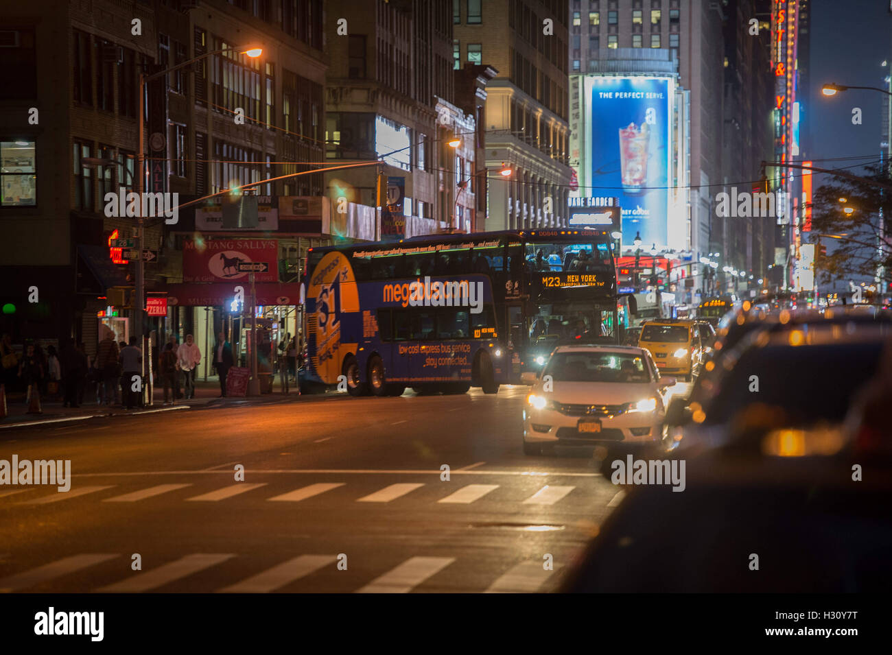 New York, NY, USA. 13th Sep, 2016. A Megabus turns onto Seventh Avenue as BoltBus and Megabus wish to move closer - Stock Image