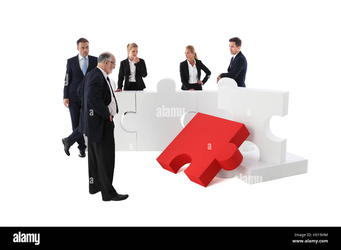 Business people team and jigsaw puzzle isolated on white background - Stock Image