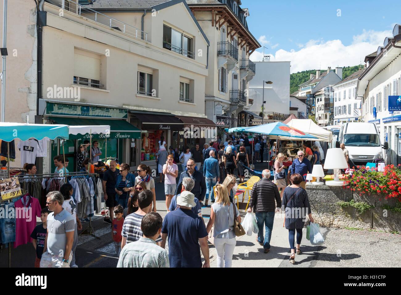 Busy street market in Divonne-les-Bains, Auvergne-Rhône-Alpes, France - Stock Image