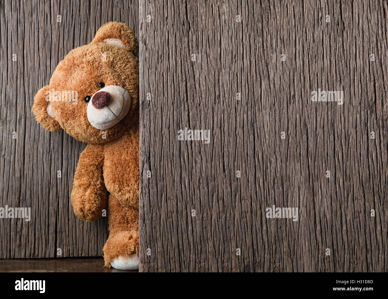 cute teddy bears on old wood background with copy space stock photo