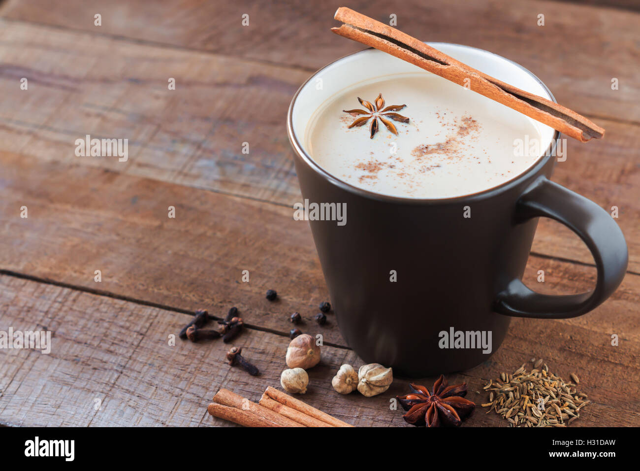 masala chai with spices. Cinnamon Stick, Thai Cardamom, Ginger, Clove, Star Anise, Black Peppercorns, Fennel Seeds, - Stock Image