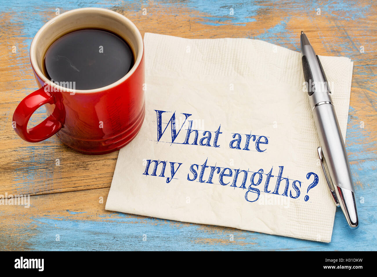 what are my strengths question - handwriting on a napkin with a cup of coffee - Stock Image