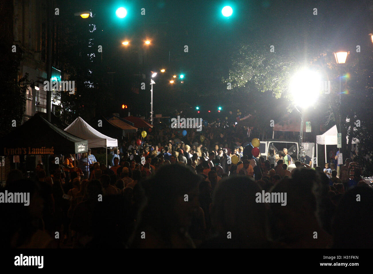 Crowd gathered at city event at night Stock Photo