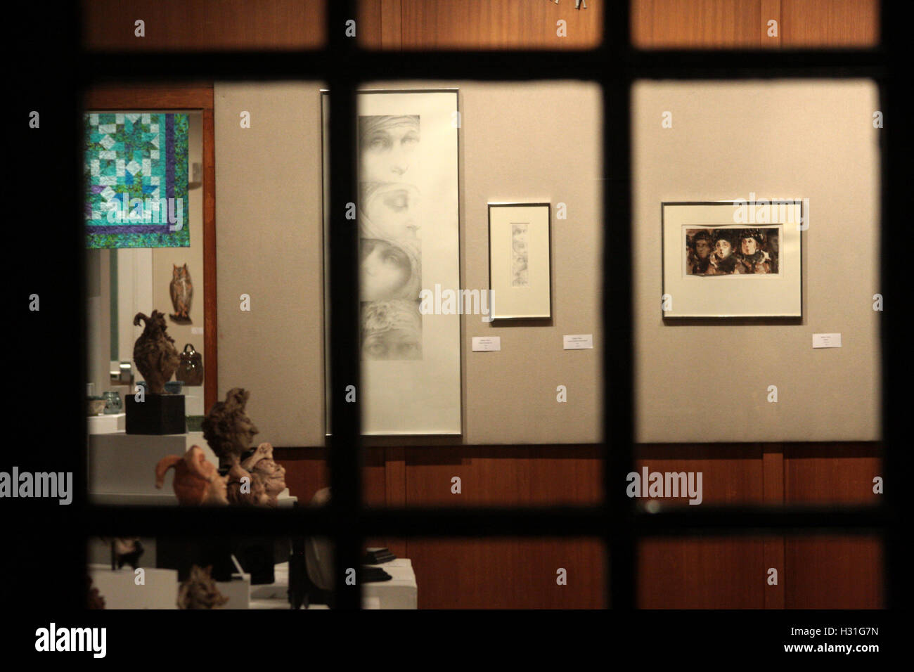 Display of framed art on the walls of an art gallery - Stock Image