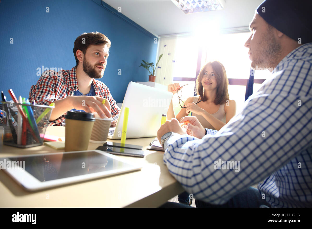 Happy web designers brainstorming about new sartup - Stock Image