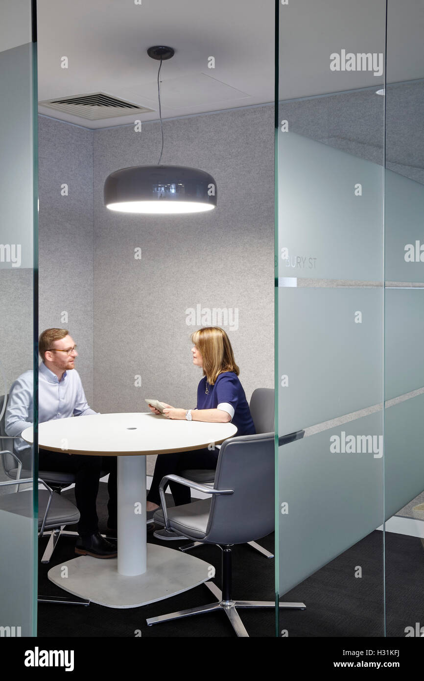 office with with large pedant light and people chatting office