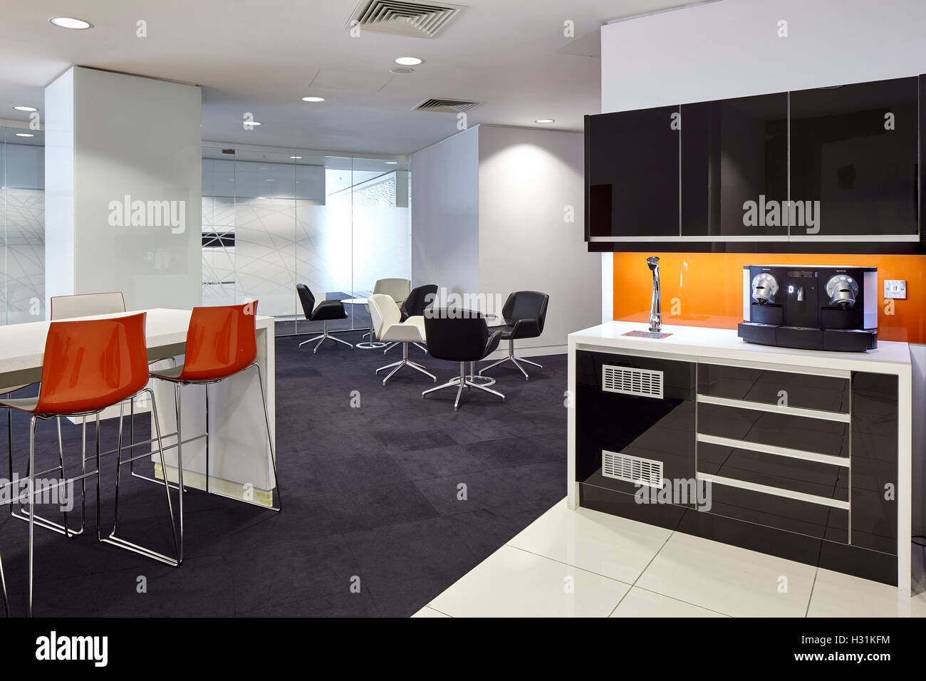 breakout area and tea point with orange detailing office space at