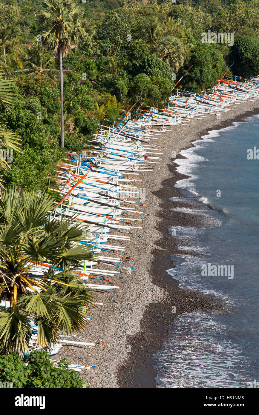 Indonesia, Bali, Amed, fishing boats lining east coast beach - Stock Image